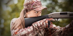 camo-hunting-gloves-hats-hunter-girl-shooting-shotgun