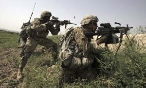 US Army soldiers return fire during a gun battle with suspected Taliban militants near the village of Jilga