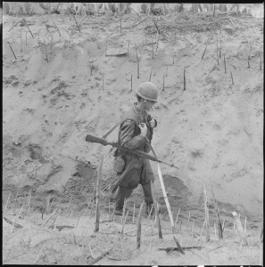 lossy-page1-800px-Vietnam....Marines_of_Company_H,_2nd_Battalion,_4th_Regiment,_walk_through_a_punji-staked_gully._-_NARA_-_532439.tif